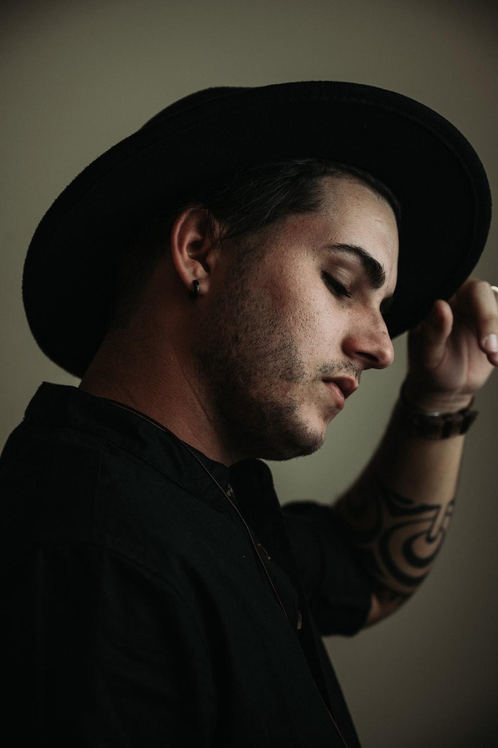 man wearing black fedora hat