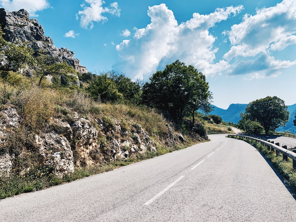 winding road on the side of a mountain slope
