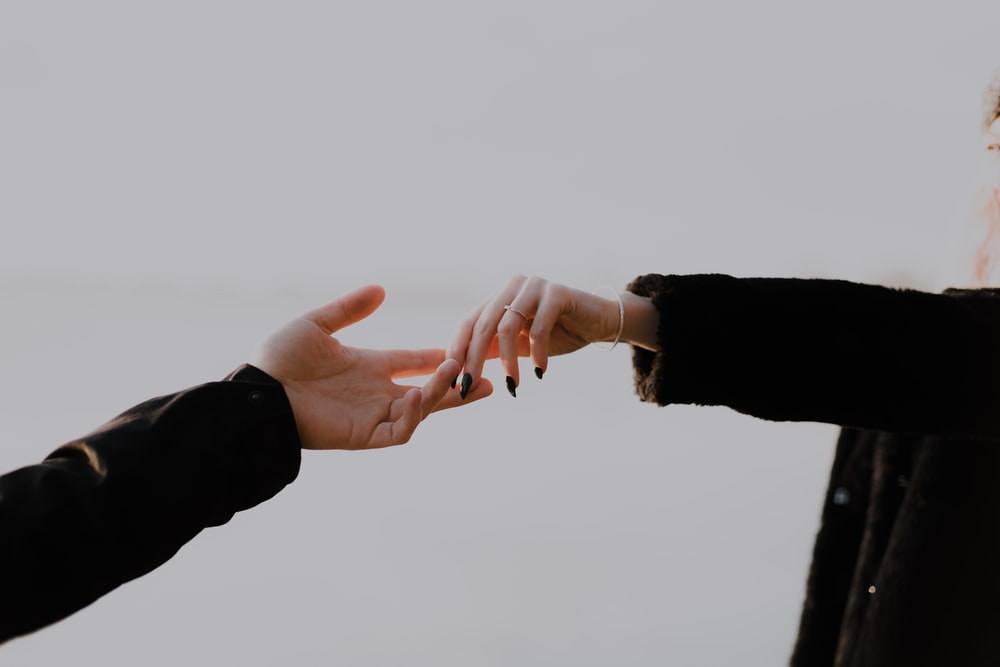 people hands reaching out