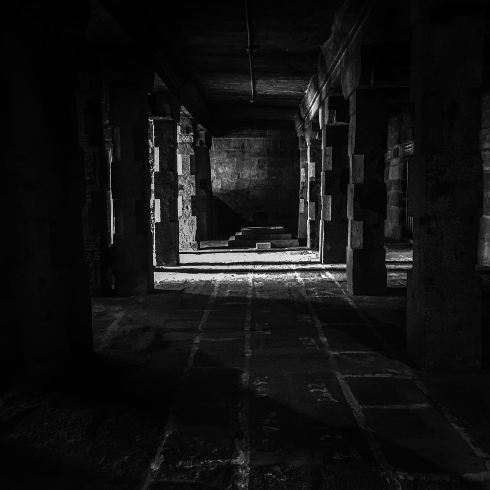 grayscale photography of underground tunnel