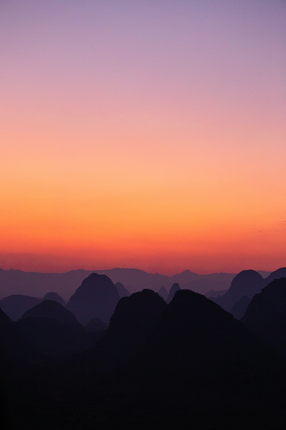 silhouette photography of mountain during dawn