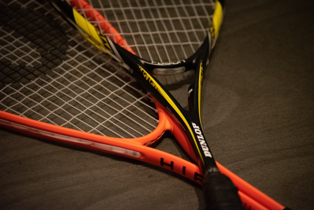 yellow and black Dunlop tennis racket