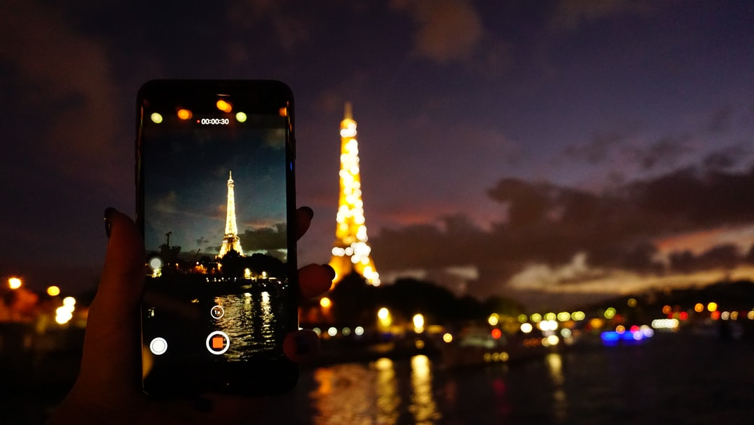 photo through cellphone camera @ Seine River in Paris at evening with beautiful sunset
