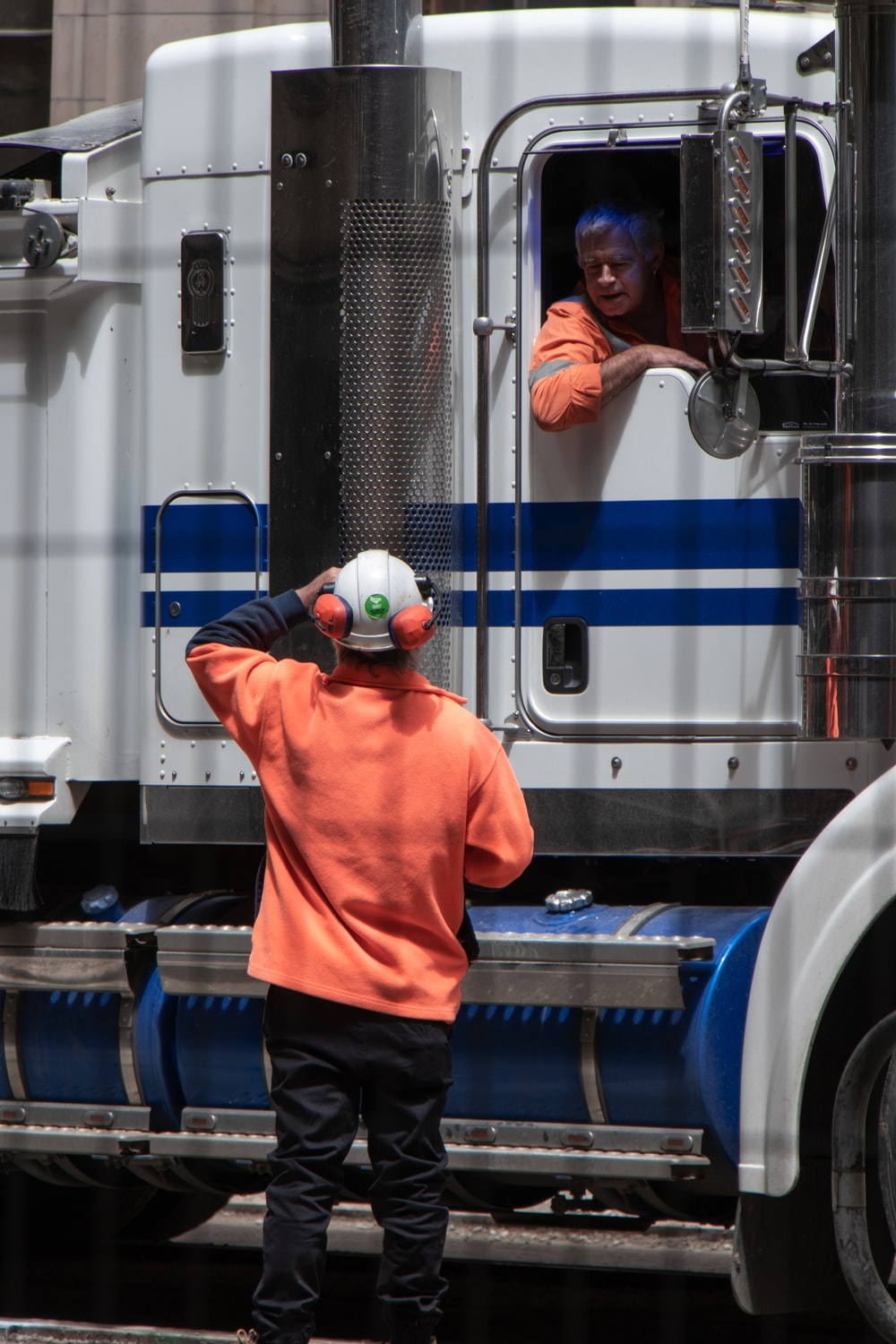 two truck drivers having a conversation