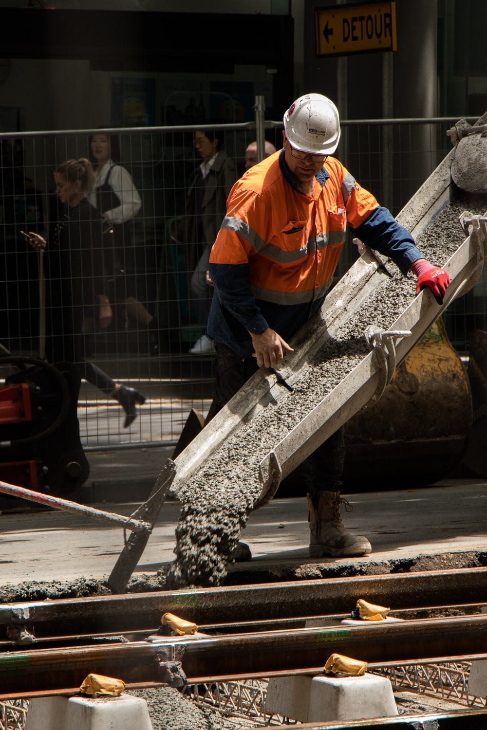 man pouring cements on road