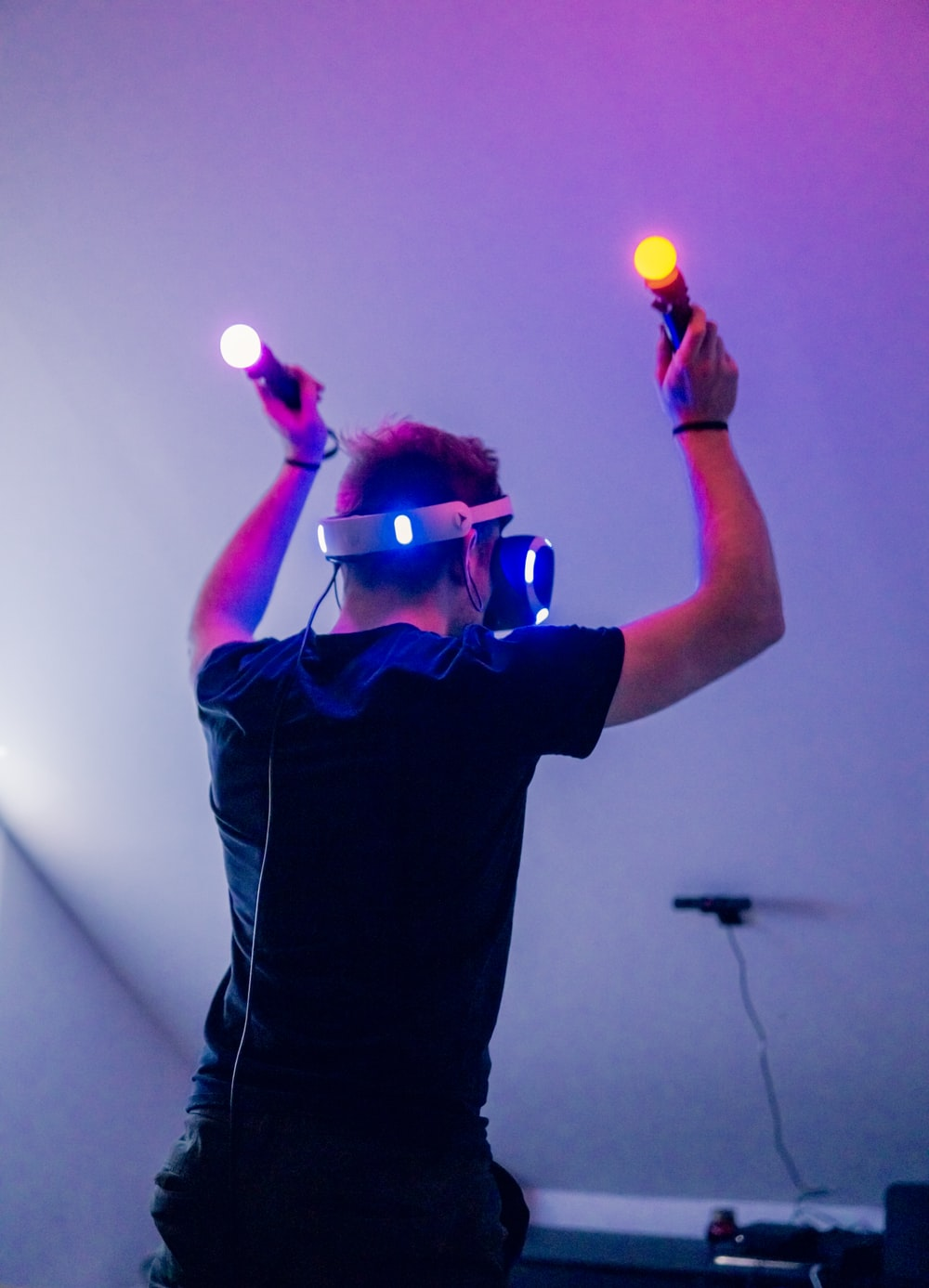 man playing using VR headset