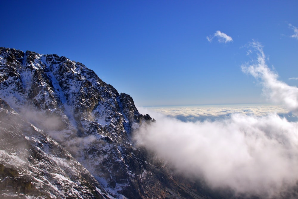 rock mountain and sea of clouds