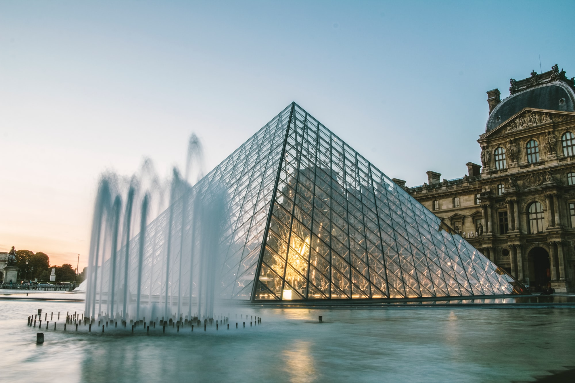 Photo of the pyramid of the Louvres in Paris France by night / golden hour
