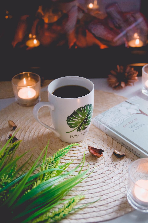 white and green ceramic mug