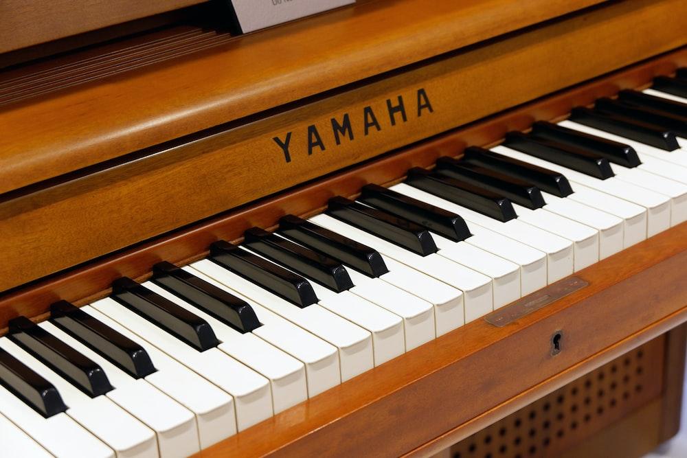 brown and white Yamaha piano