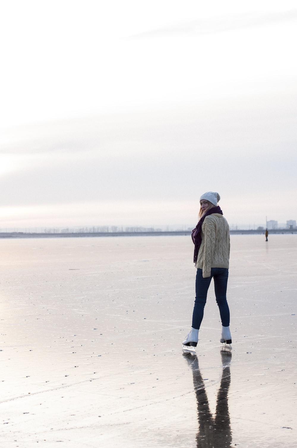 woman ice skating during daytime