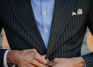man wearing balck suit jacket