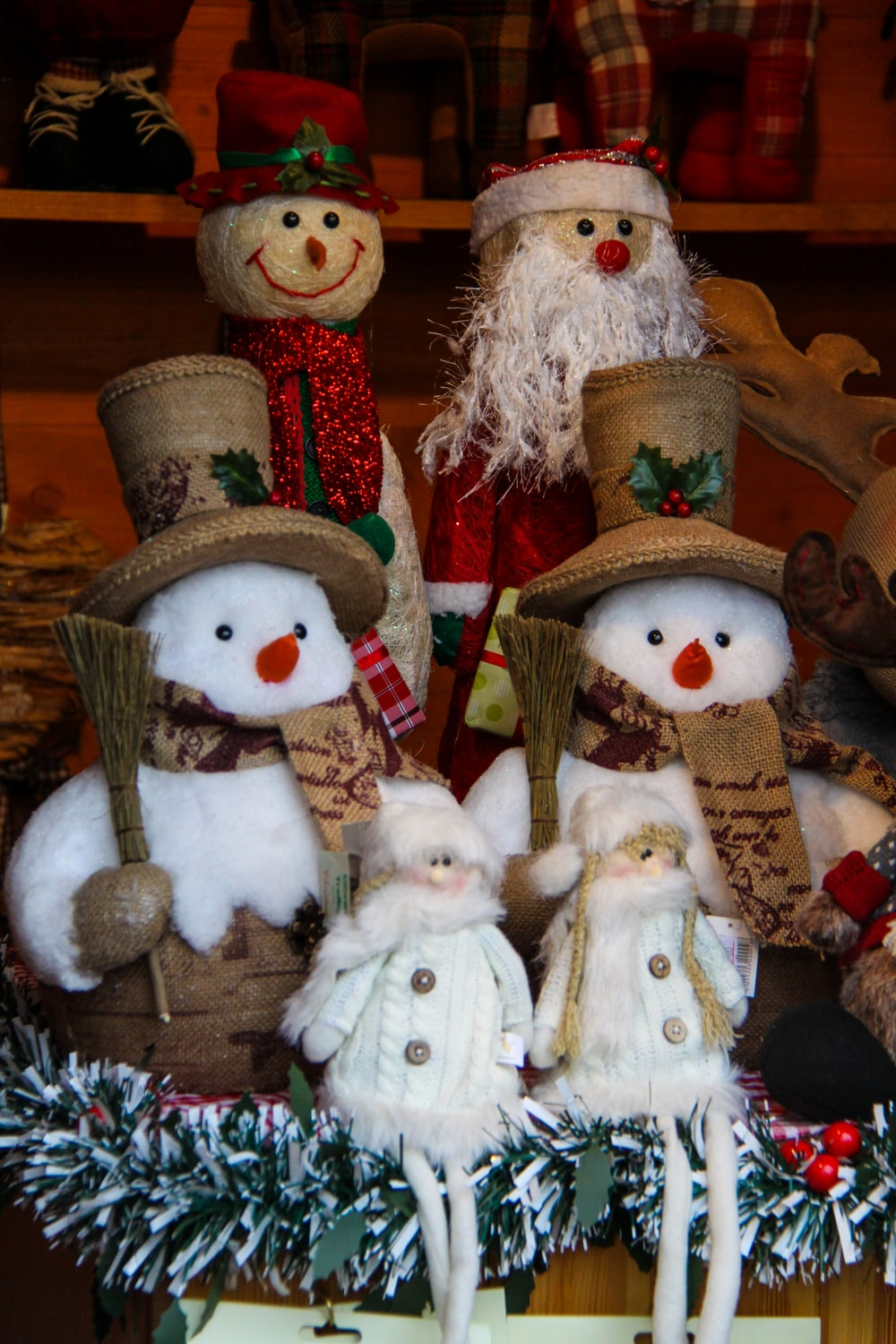 several Santa Claus and snowman plush toys