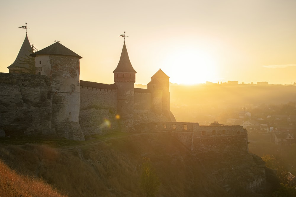 castle on a cliff during golden hour