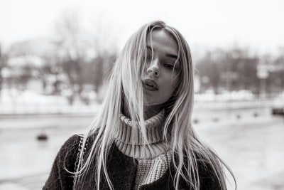 grayscale photography of coat and turtle neck sweater