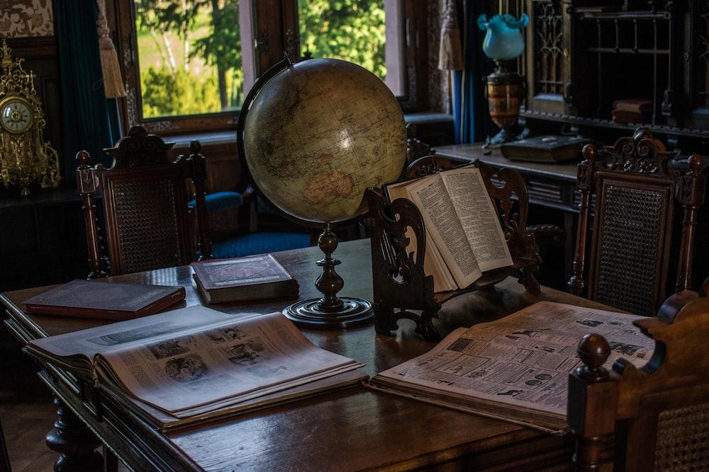 desk globe on wooden table