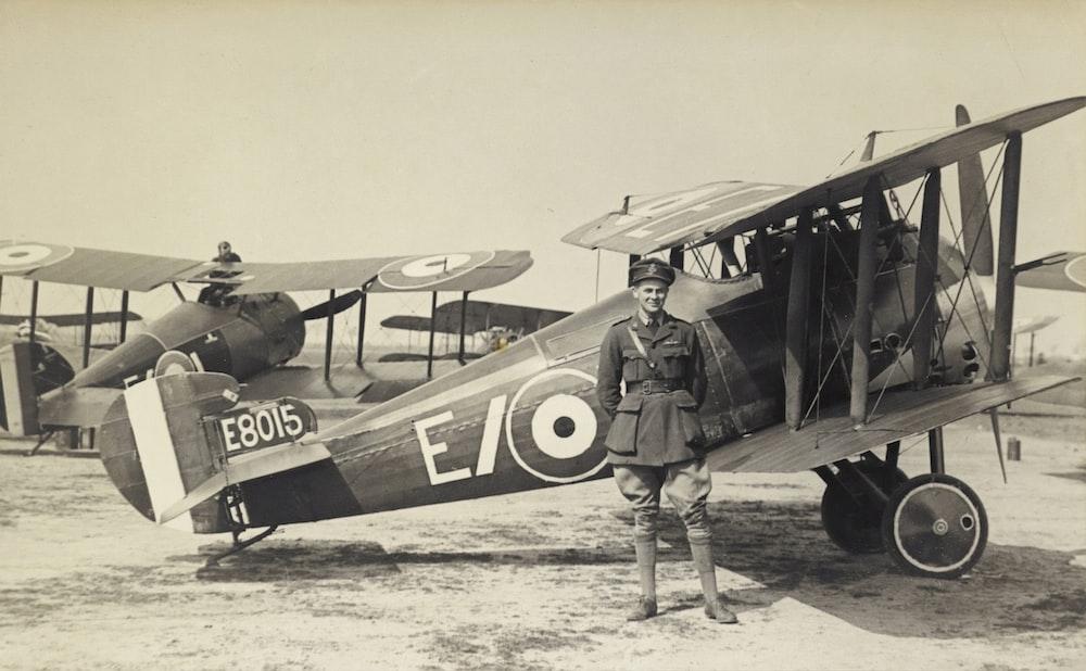 vintage photo of man beside of airplane