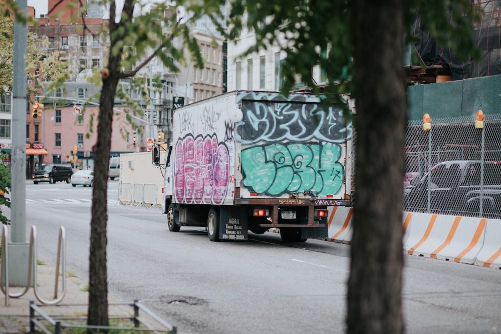 white enclose van on road