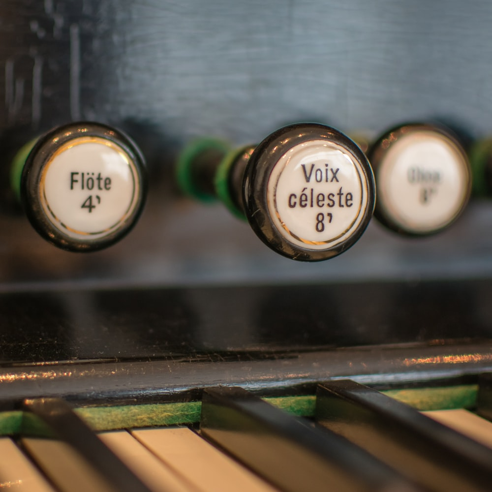 black and beige piano