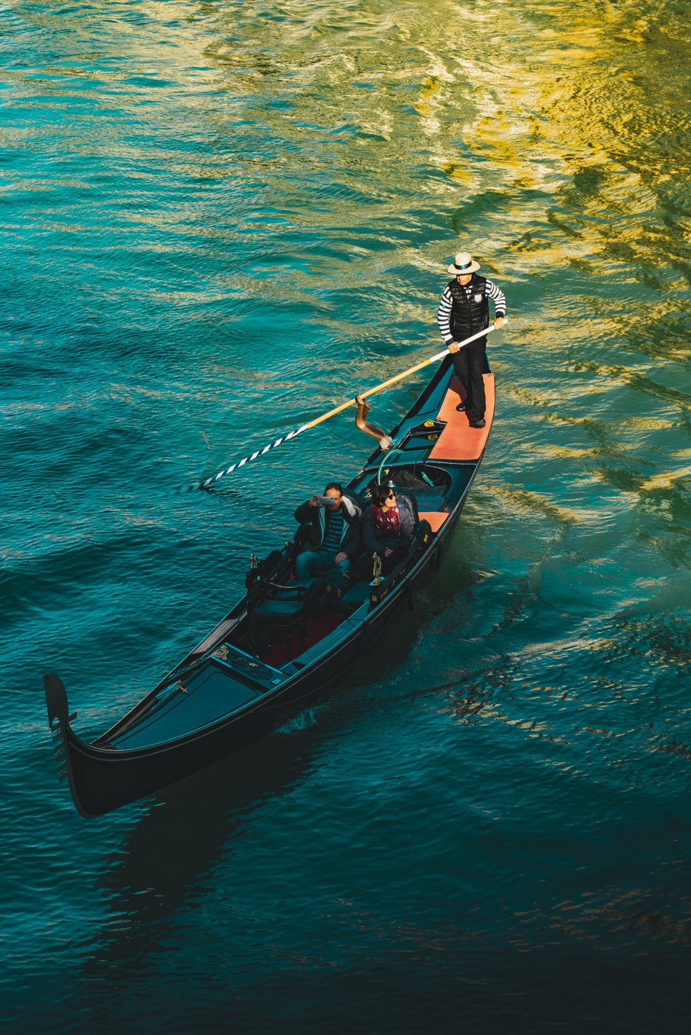 people on boat on body of water