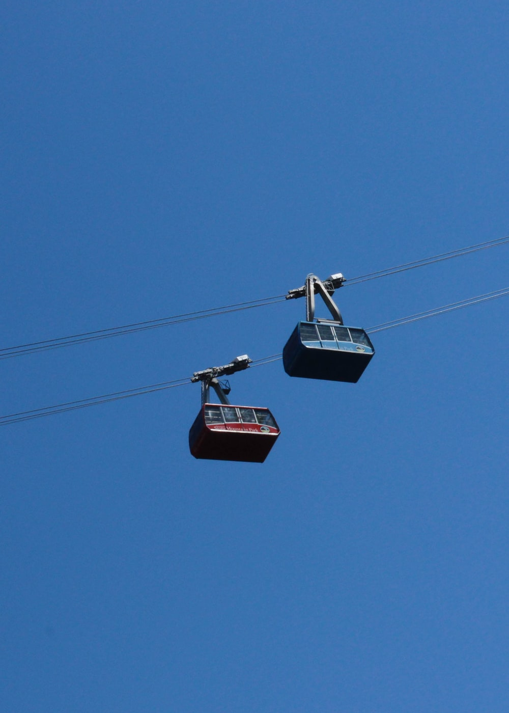 two red and blue cable cars