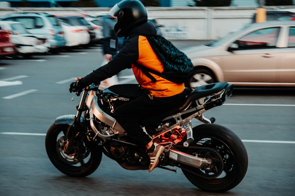 person riding on motorcycle