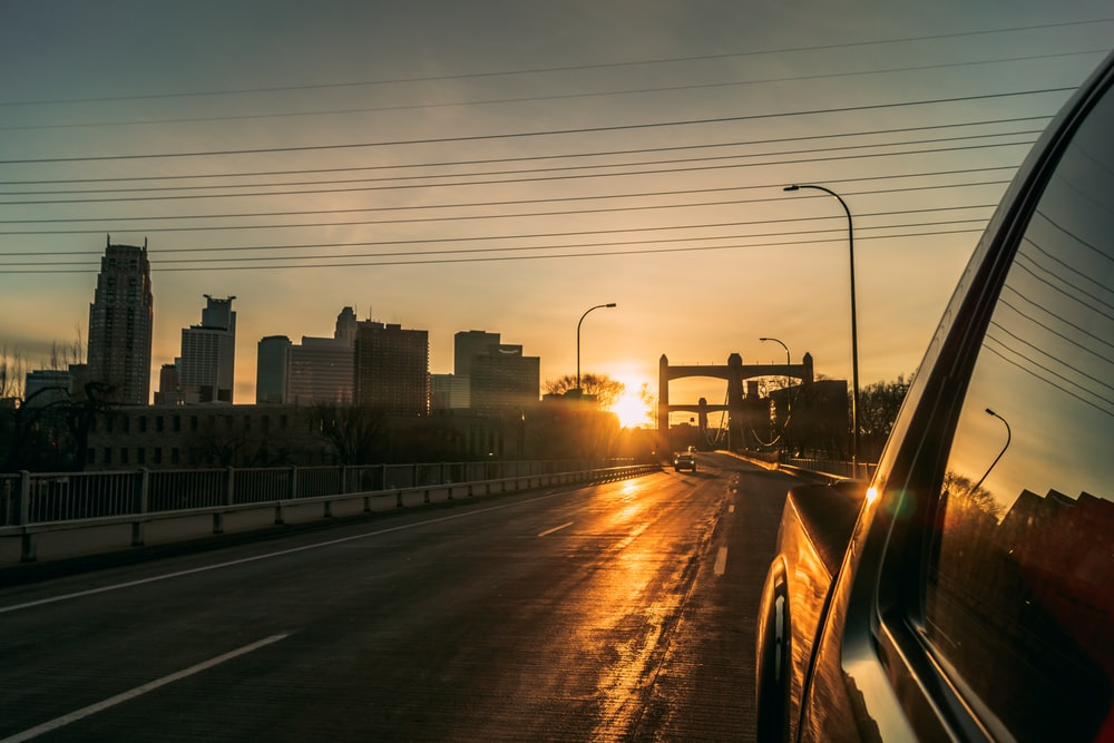 vehicle on roadway during golden hour