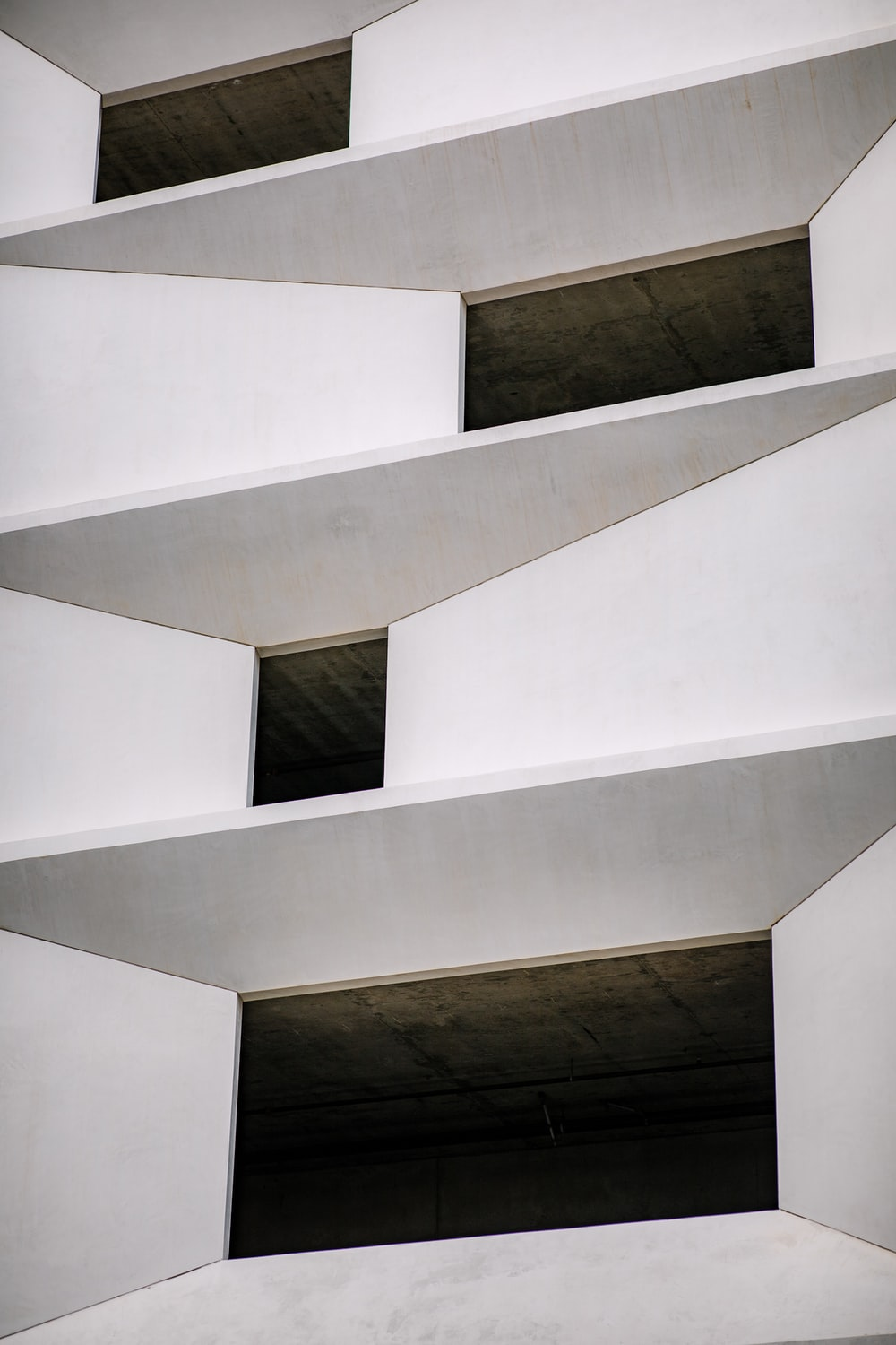 close-up photography of white concrete building