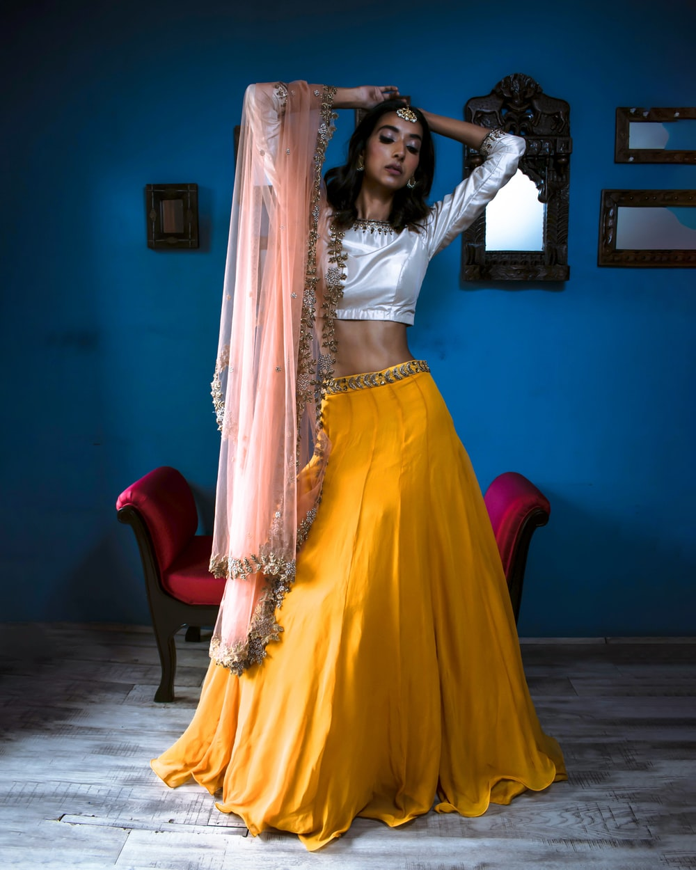 woman wearing white crop top and yellow long skirt