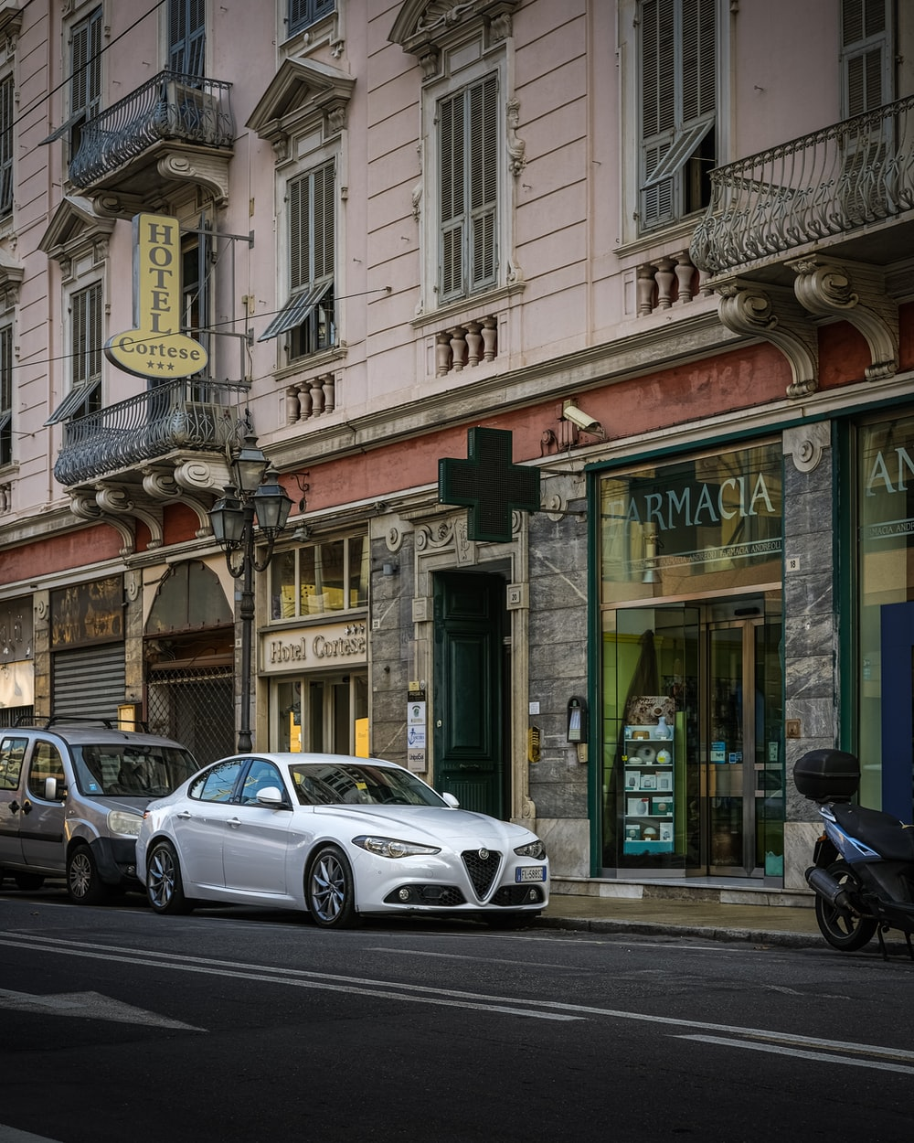 silver Bugatti sedan in front of concrete building