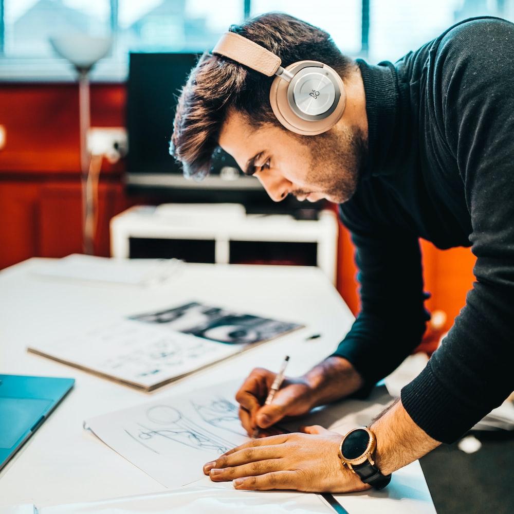 man wearing headset drawing