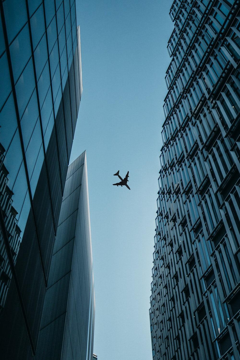 flying airplane above high-rise airplanes
