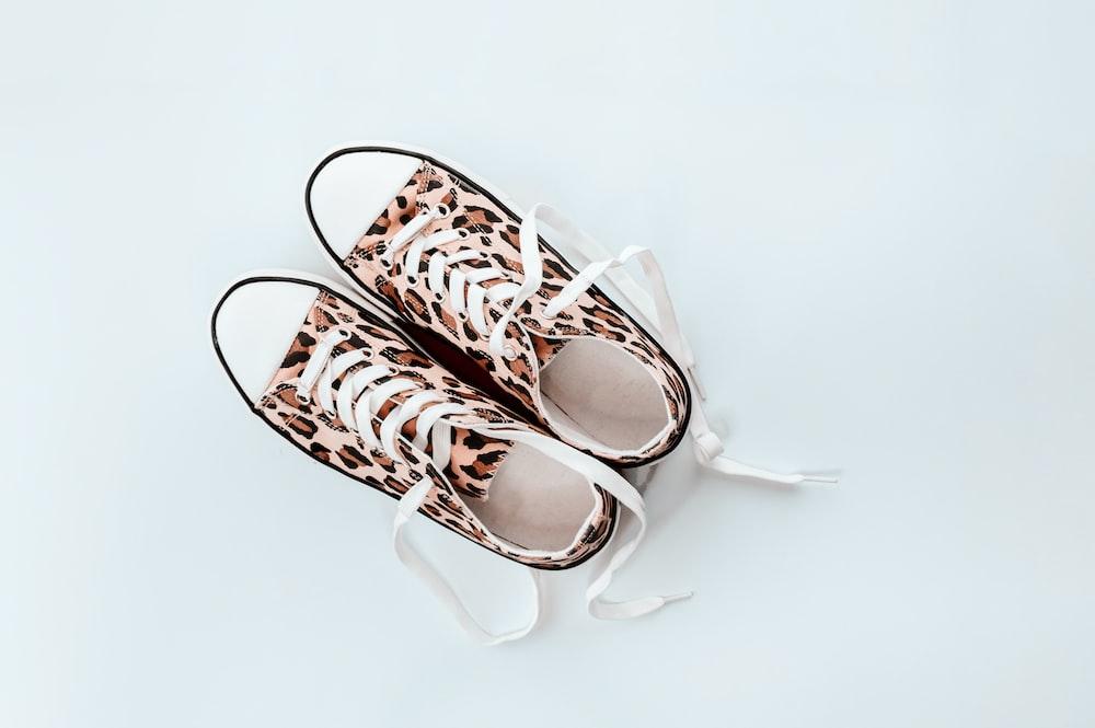 pair of brown-and-beige leopard print low-top sneakers