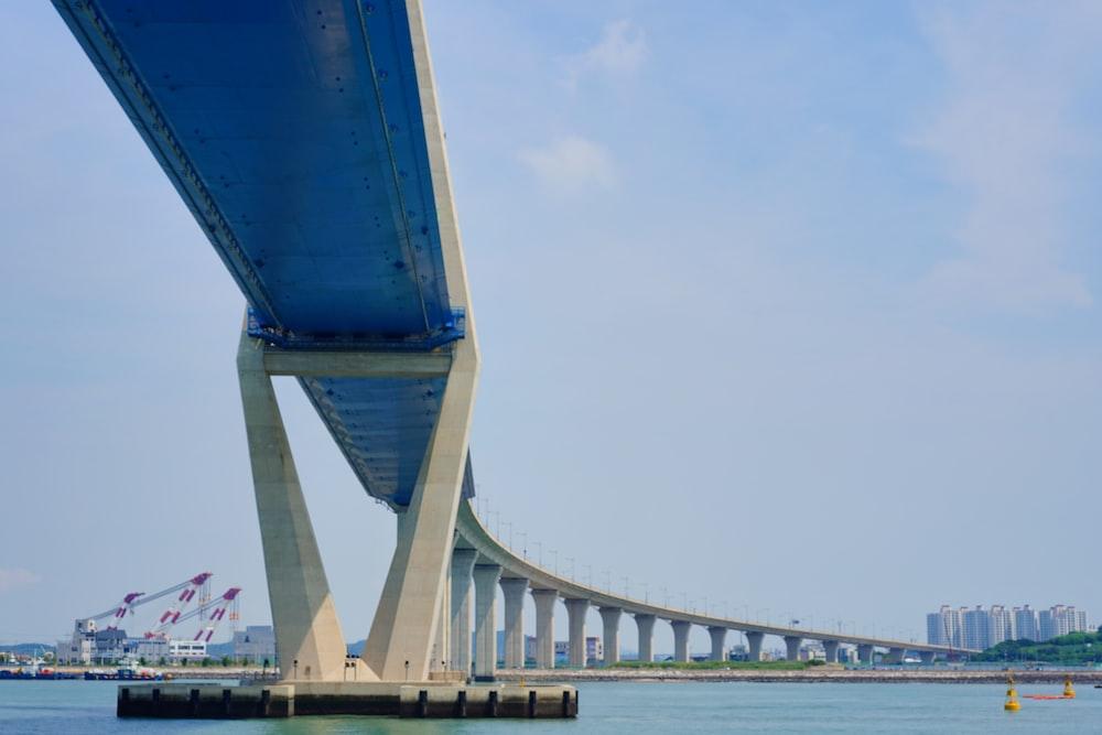 concrete bridge over water at daytime