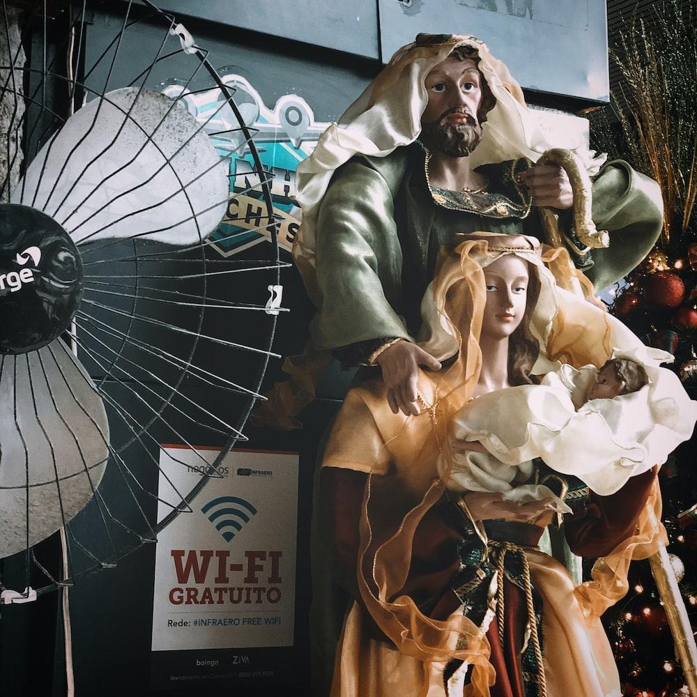 religious statues near electric fan
