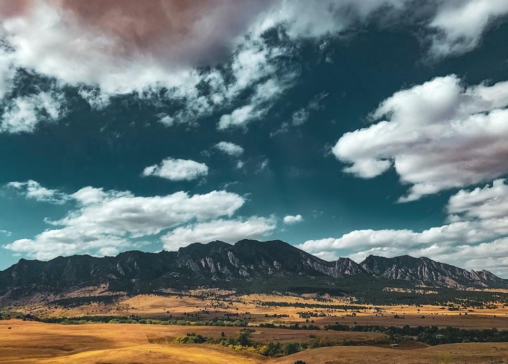 mountains under blue skies