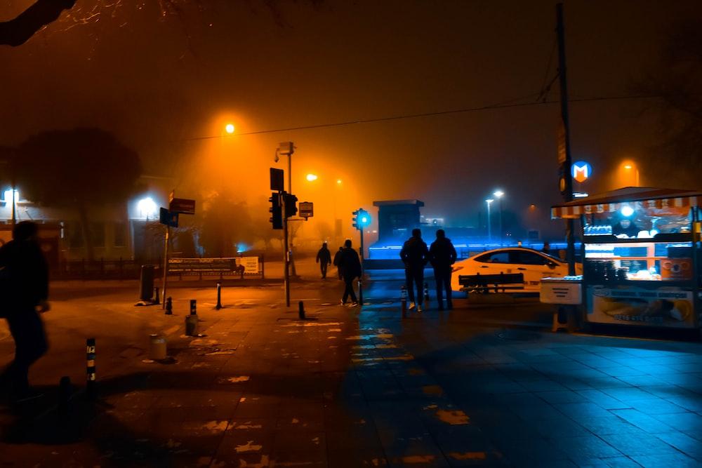silhouette photo of people walking on street
