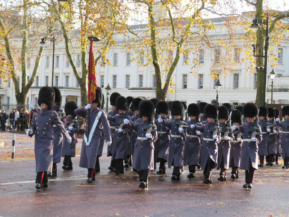 parade of soldiers during daytime