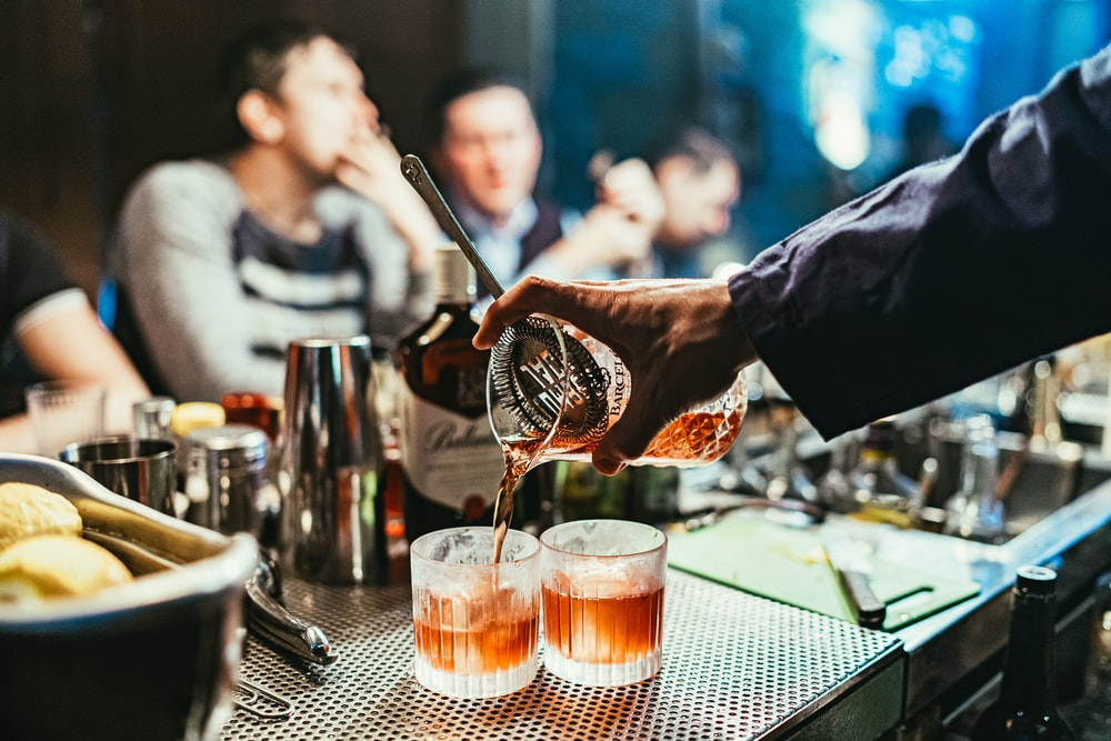 man pouring drink