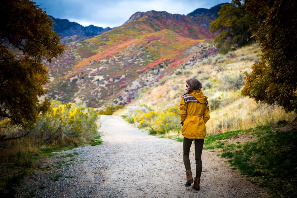 woman walking near hills