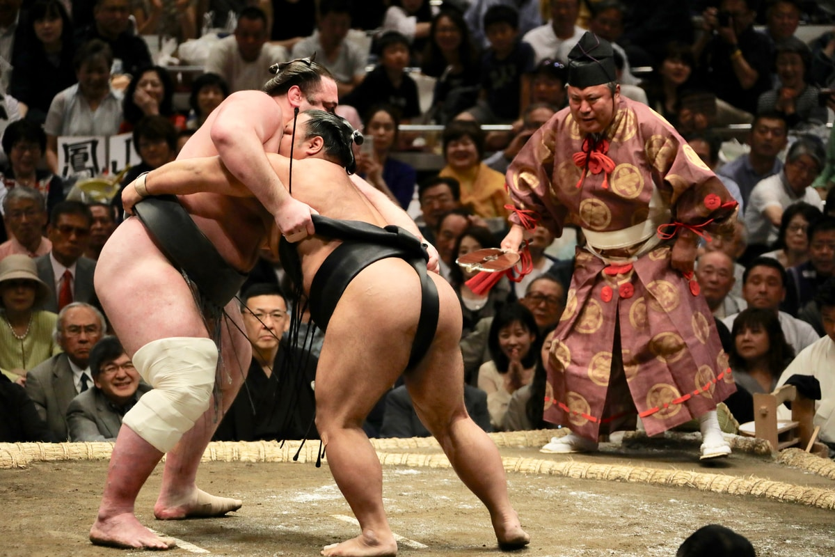 two men in sumo wrestling