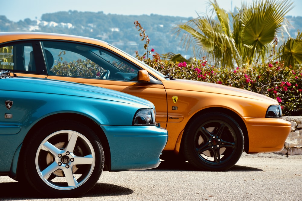 two blue and orange cars