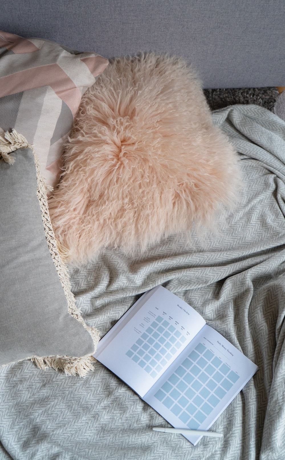 gray pillow and white books
