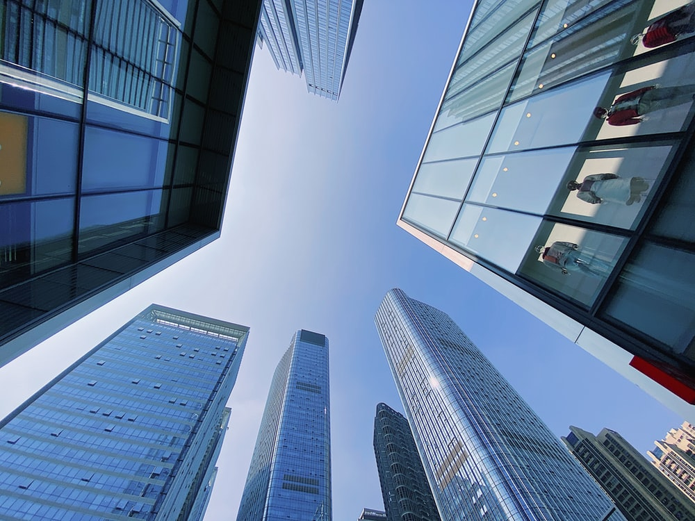 low angle photography of highrise buildings during daytime