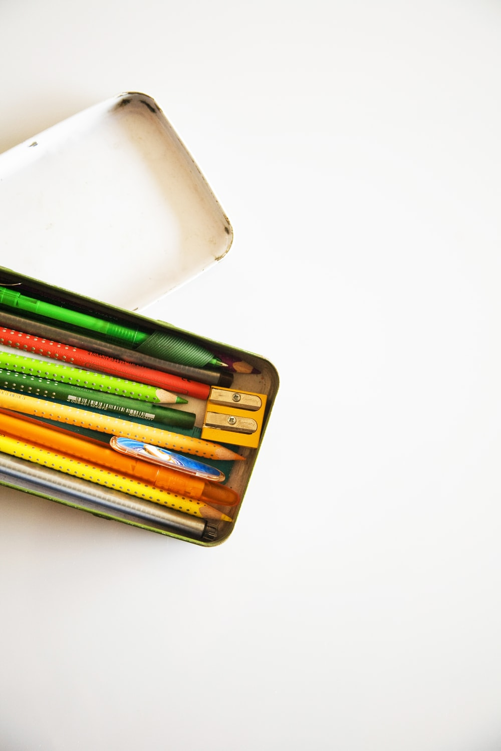 assorted-color pencil and pens inside pencil case