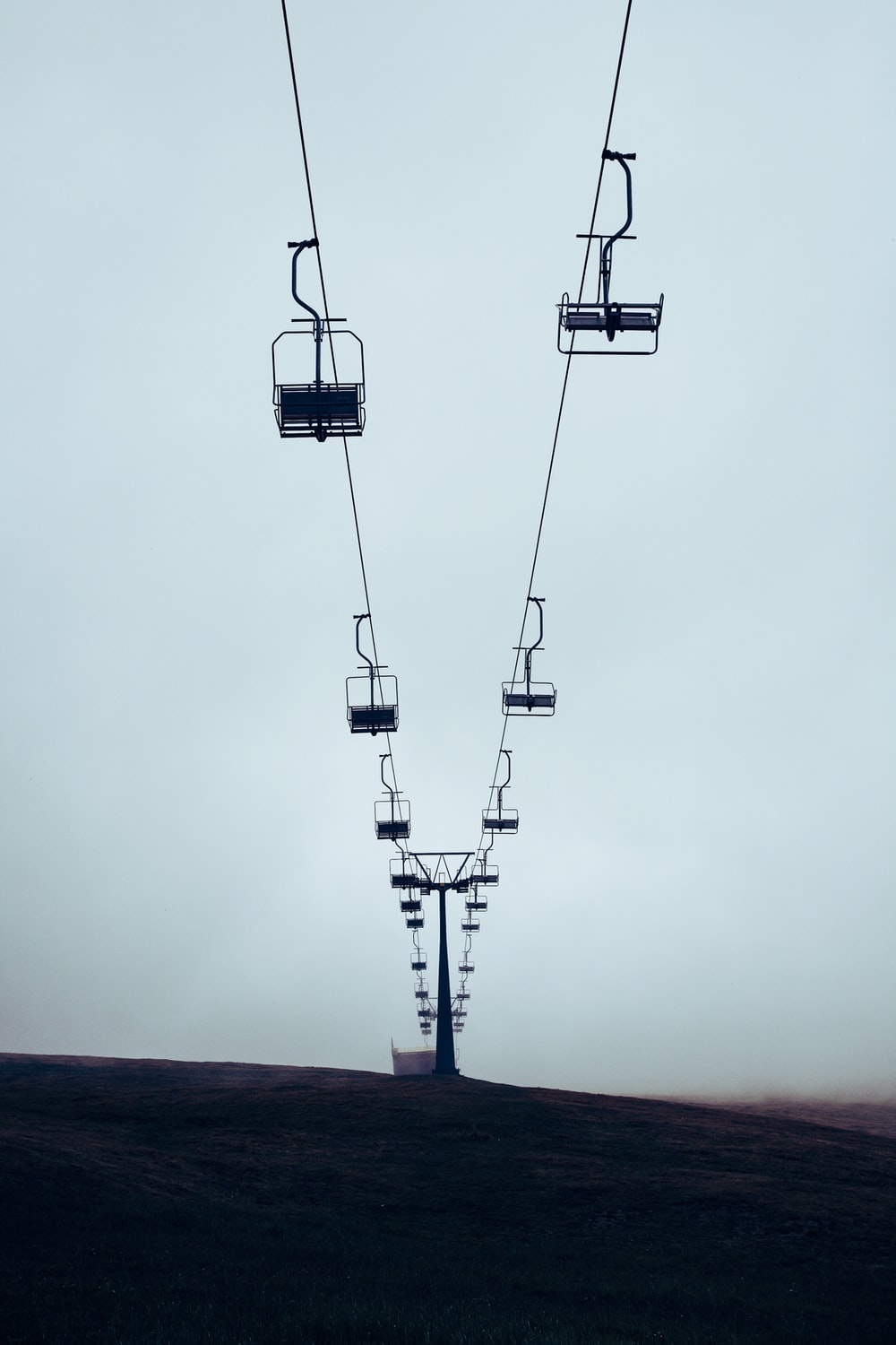 low angle photography of cable cars during daytime
