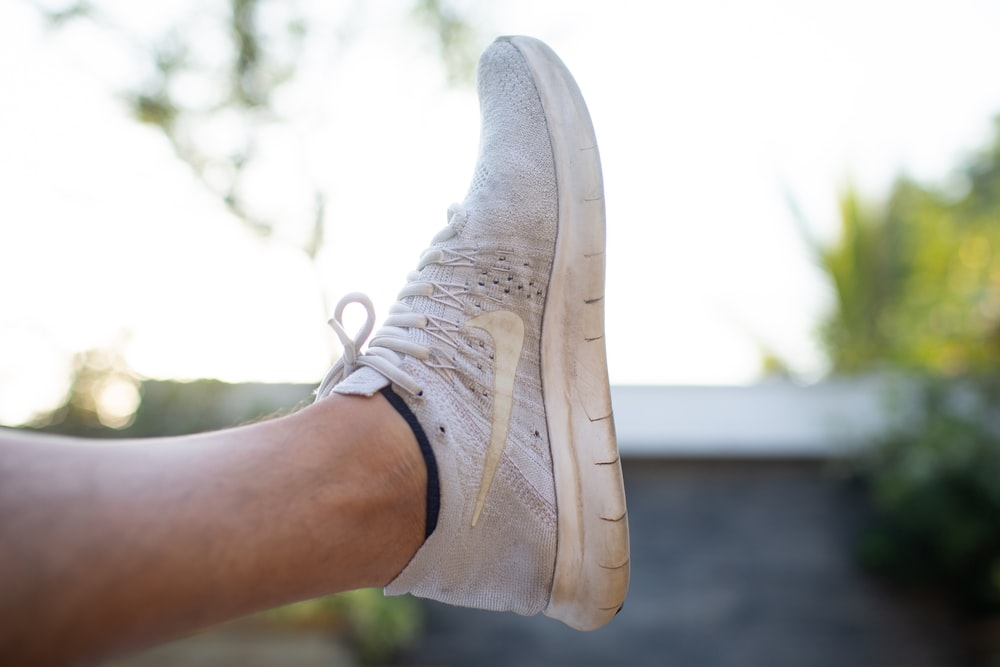person wearing white nike air force 1 low
