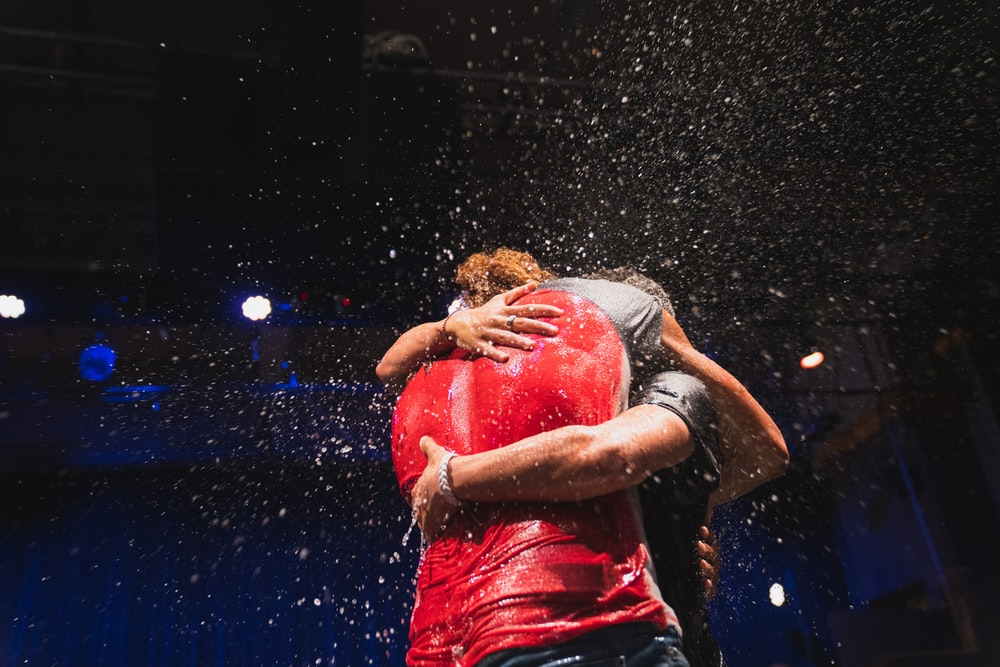 two people standing and hugging
