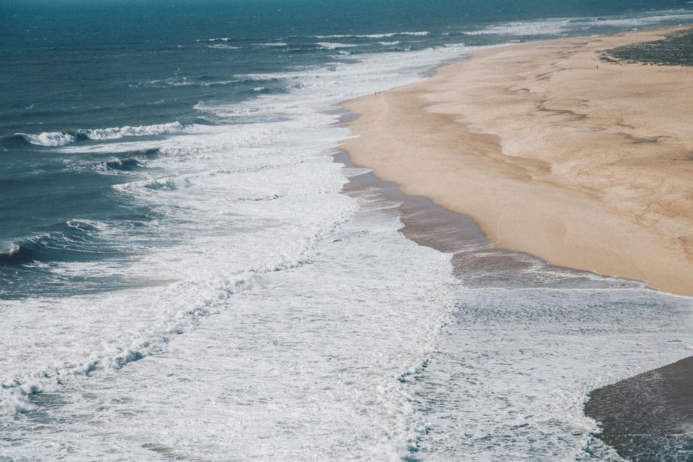 top view of waves on shore