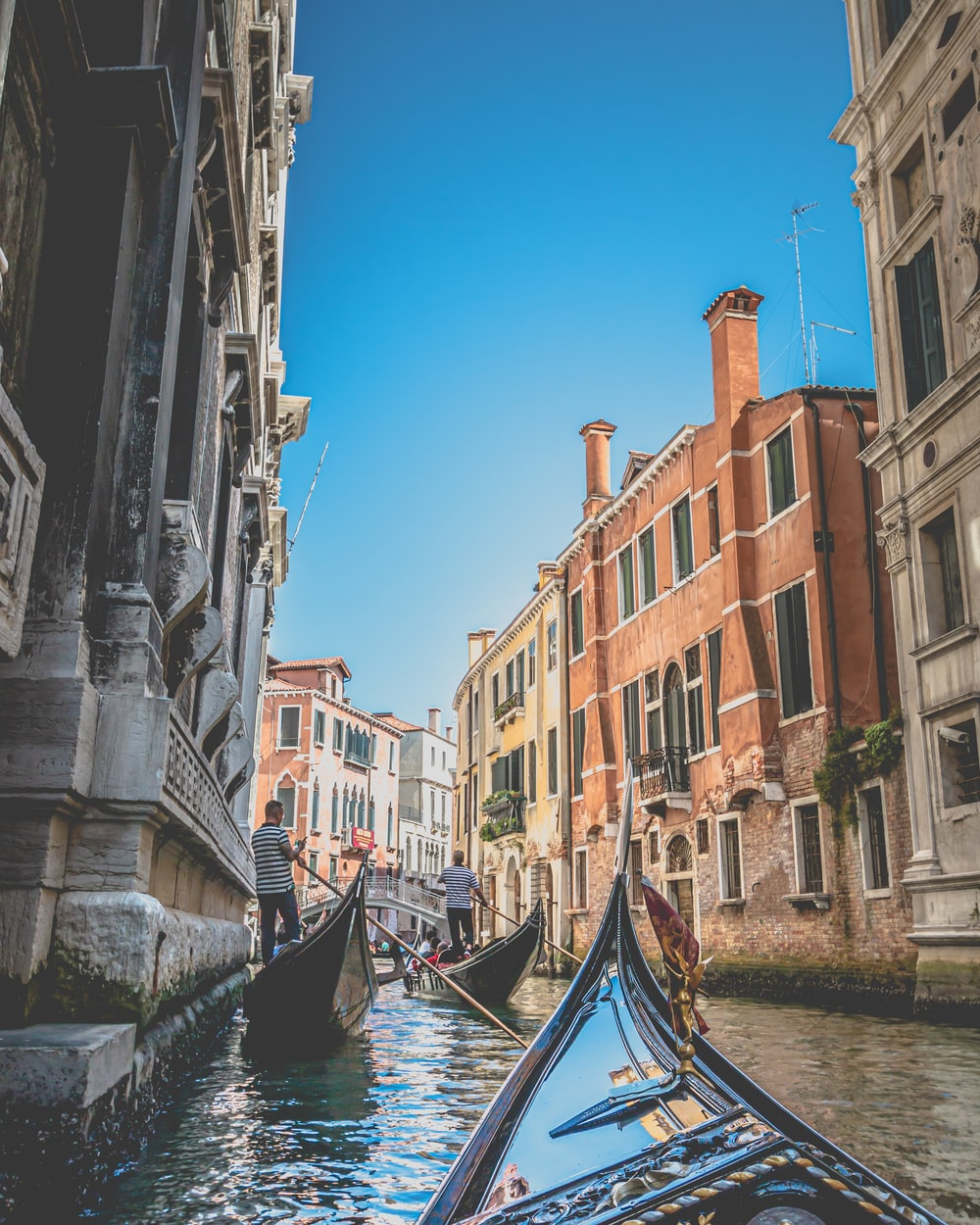 gondola boats in a canal in Venice, Italy